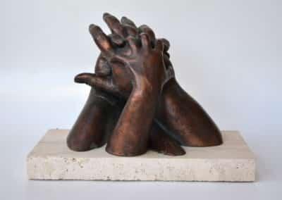 Las manos de los cuatro componentes de la familia de Ruth en estas Navidades